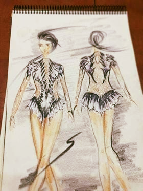 front and back hand drawings of figure skaters costume