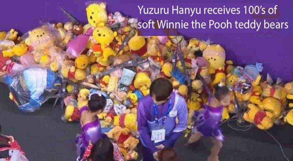 Yuzuru Hanyu receives loads of wininie the poo teddy bears after his olympic figure skating performance