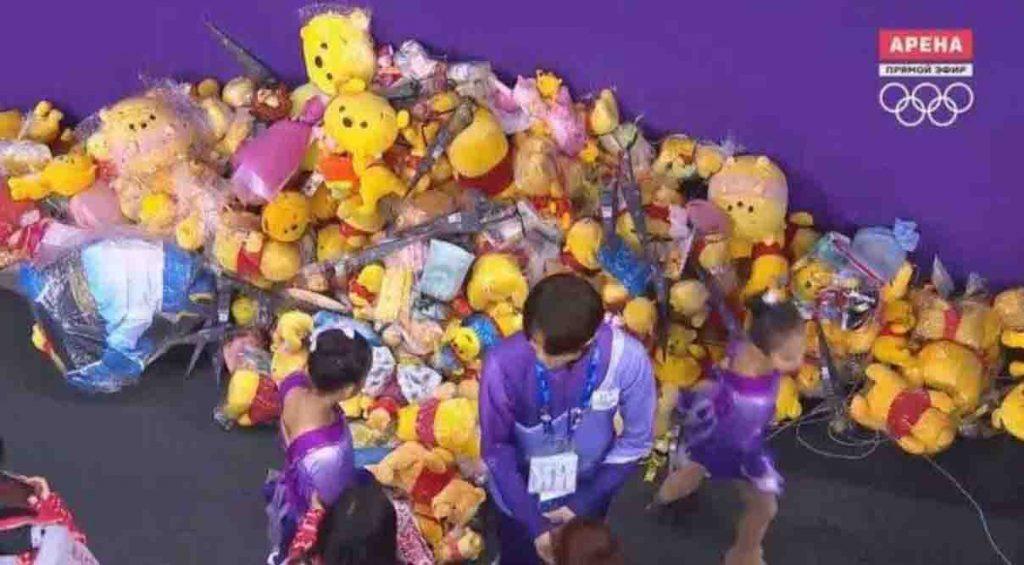 Yuzuru Hanyu receives a teddy bear after his olympic figure skating performance